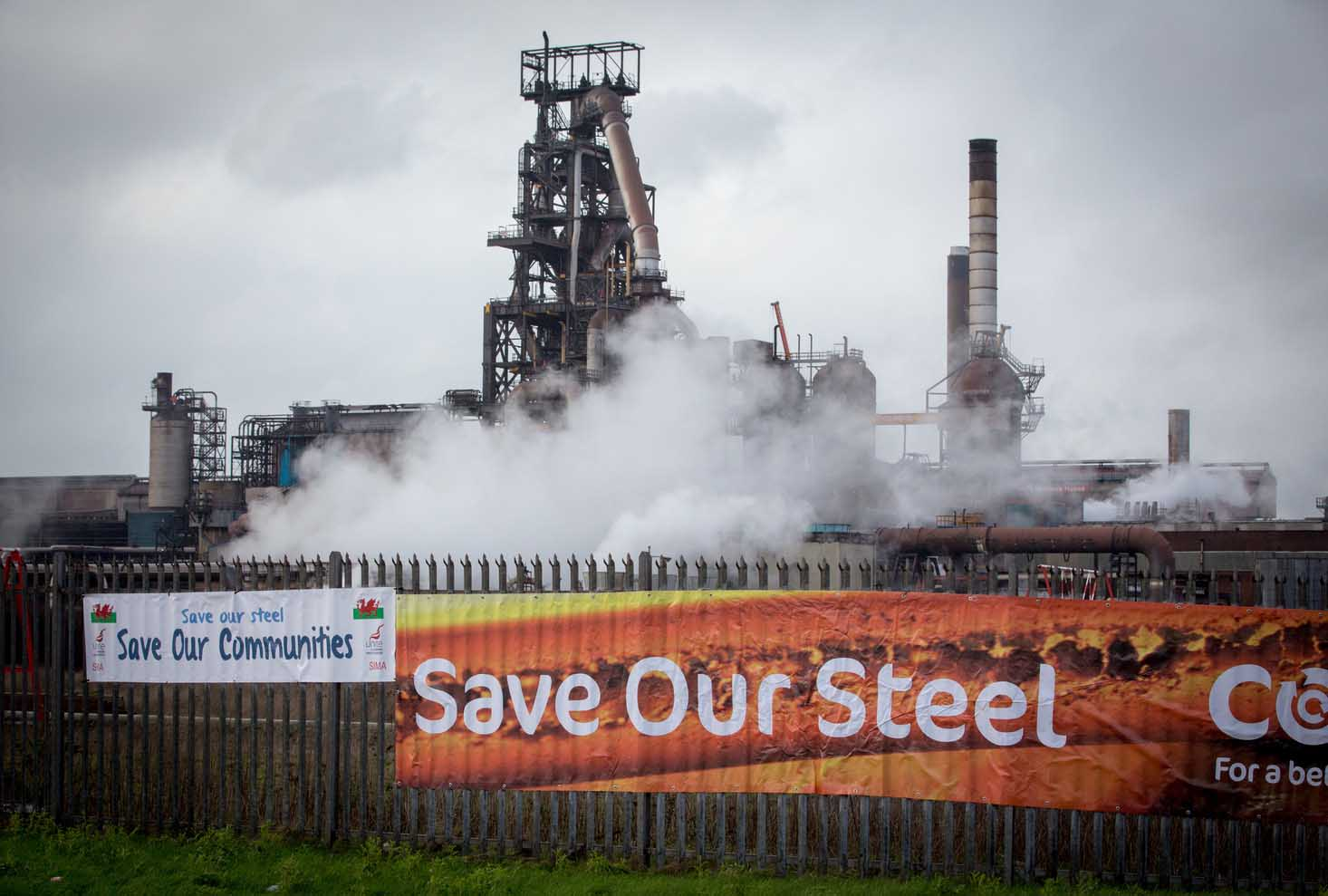 PORT TALBOT, WALES - JANUARY 18:  A poster is displayed outside the main gates of the Tata steelworks on January 18, 2016 in Port Talbot, Wales. Tata Steel has confirmed today that it plans to cut 1,050 jobs in the UK, including 750 at Port Talbot which is the UK's biggest steelworks.  (Photo by Matt Cardy/Getty Images)